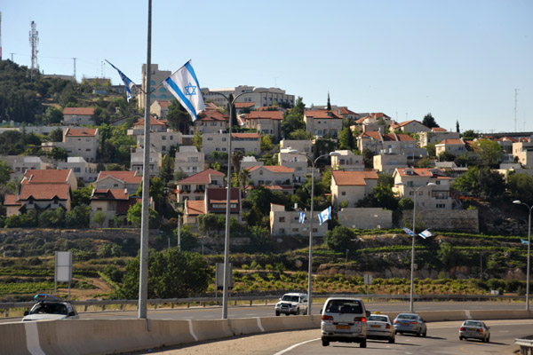 Highway 60 lined with Israeli flags as it passes the Israeli settlement of Efrata (Gefen)