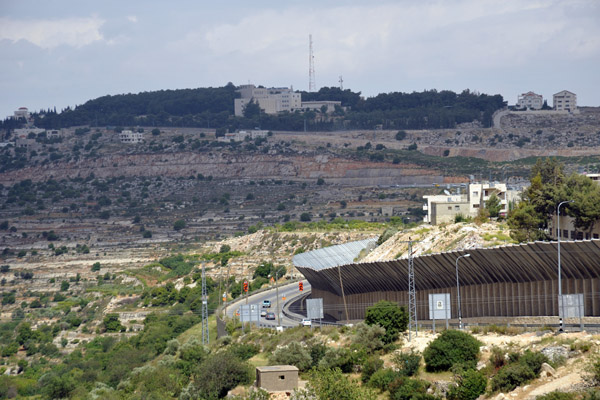 West Bank Separation wall built extra high to protect the Israeli cars driving on Highway 60 from Palestinian stone-throwers