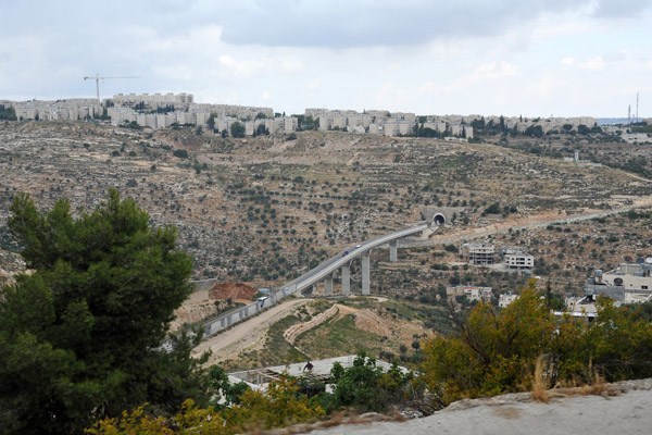 View of road tunnel on Highway 60 from Beit Jala with the Israeli settlement of Gilo (est 1973, pop 40,000) on the hilltop