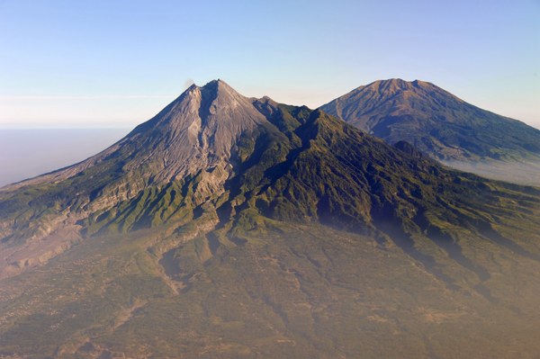 Mt. Merbabu comes into view behind Merapi