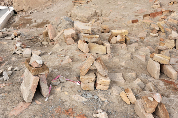 Local people construct these little brick piles for luck