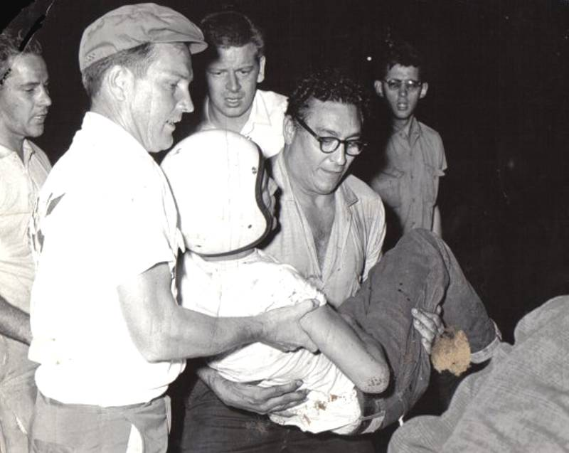 Tony Formosa Sr.  carrying a severly injured, Doc Norris.