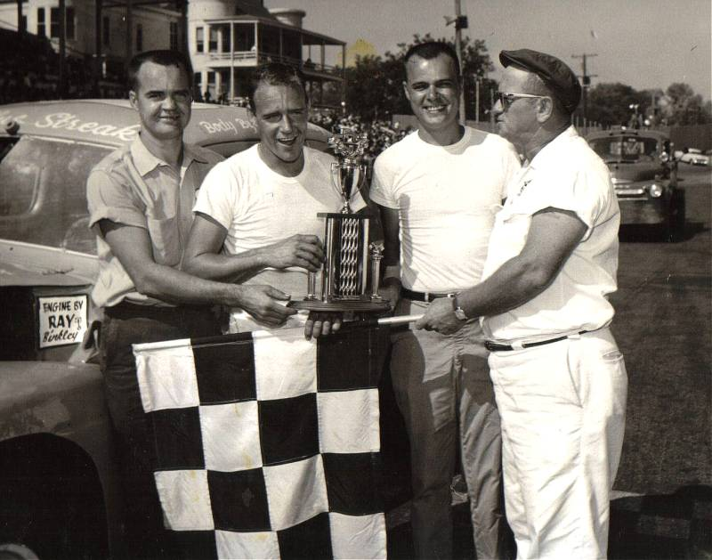 Ray, Charles, and Roy Binkley with flagman Forest   Prince. Win again.
