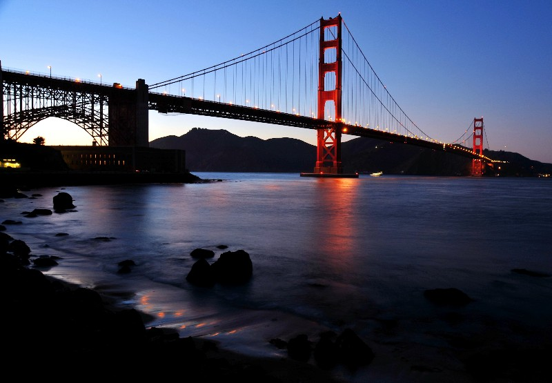 gold and red of Golden Gate Bridge