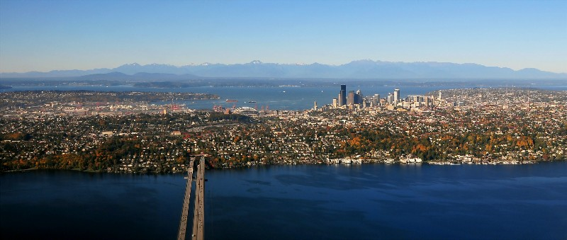 Seattle with floating bridge and Olympics