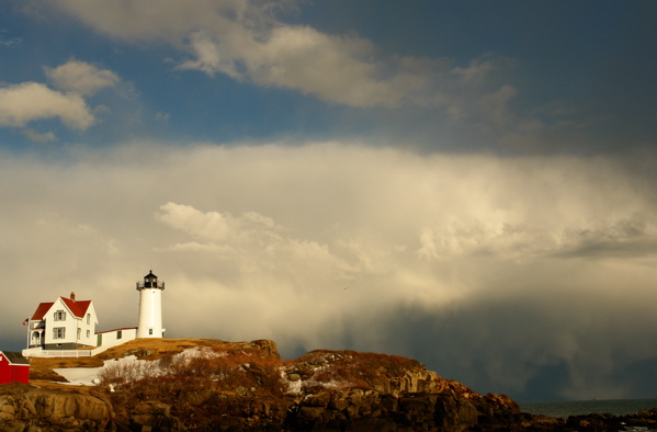 2417!2383462DSC03440800/108.jpg   WATERSPOUT OVER DISTANT BOON LIGHT STORMFRONT RAGES THRU NUBBLE LIGHT WITH SNOW AND SUN