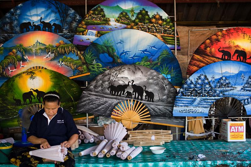 An artist prepares the umbrella in the umbrella factory..