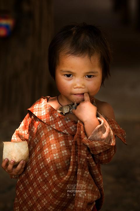 Young sister, Laos border town