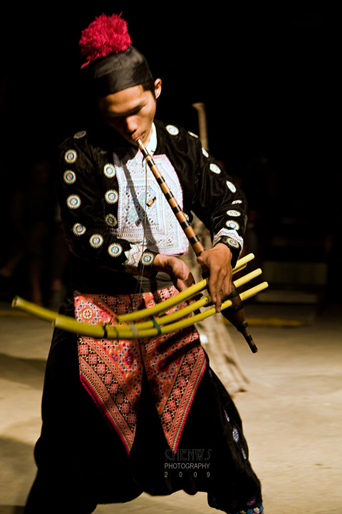 Hmong playing bamboo flute