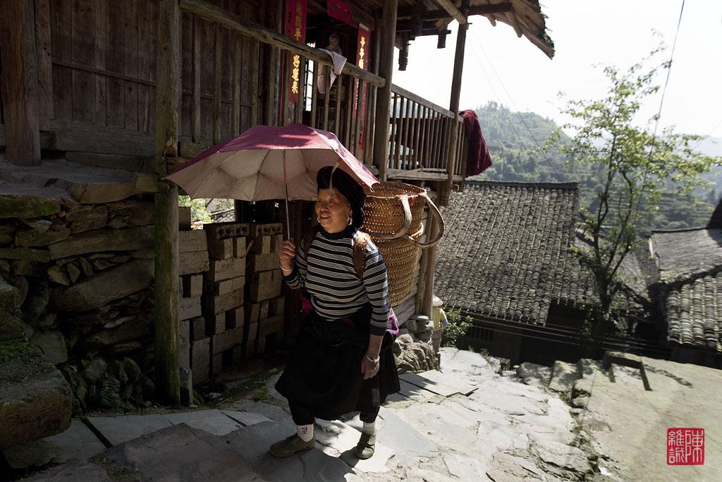 Yao lady walking home in Da zai, GuangXi province.