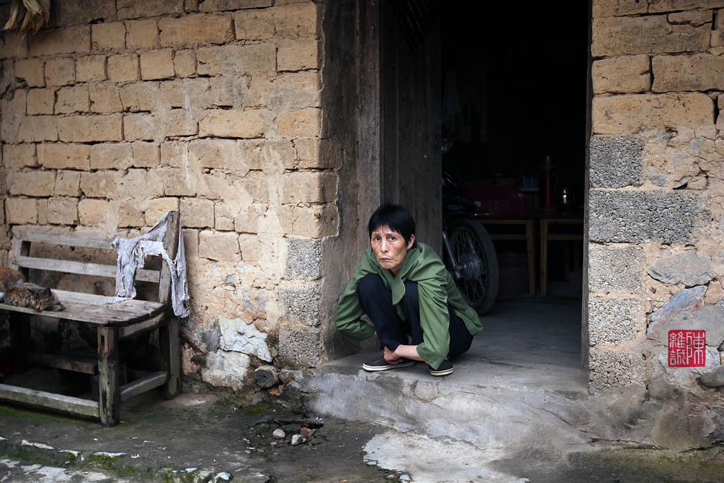 Resting at the doorstop, village in Xingping.