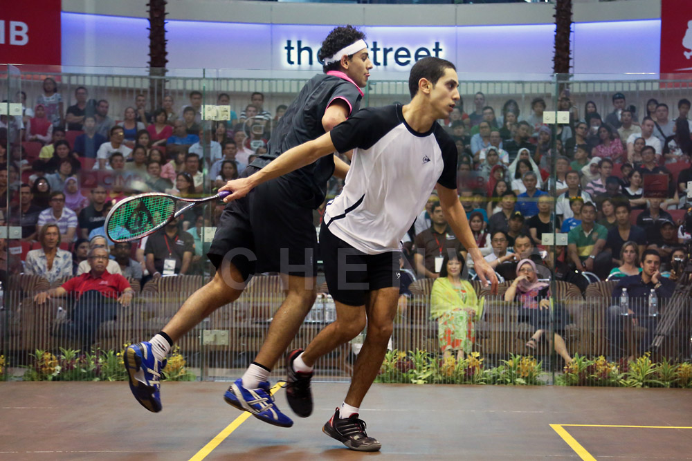 Mens final: Tarek Momen upset Mohamed El Shorbagy in a tensely fought match.
