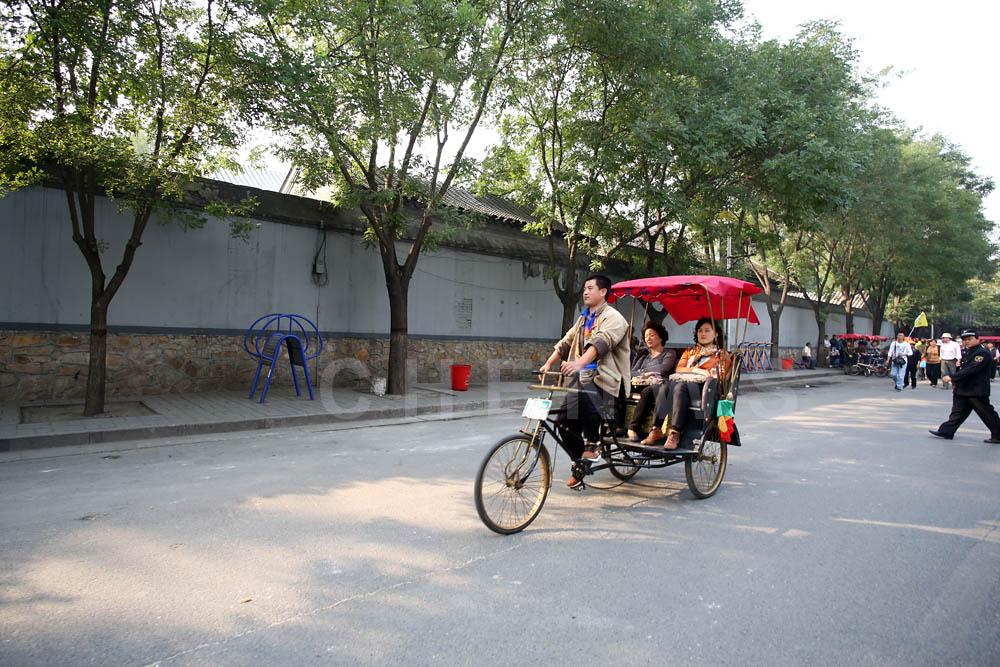 Visitors take a trishaw ride
