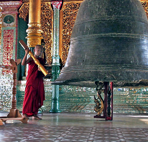 Young monk rings bell