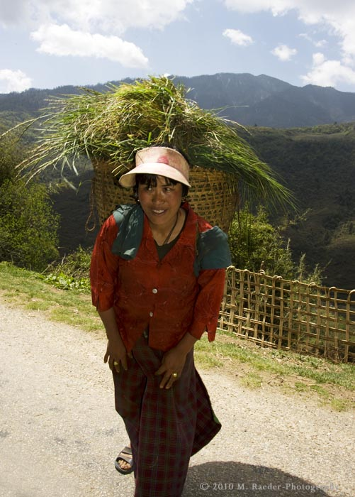Woman taking her harvest home