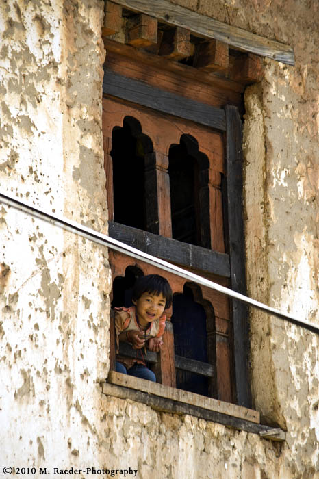 Girl in window; Rinchengang Village