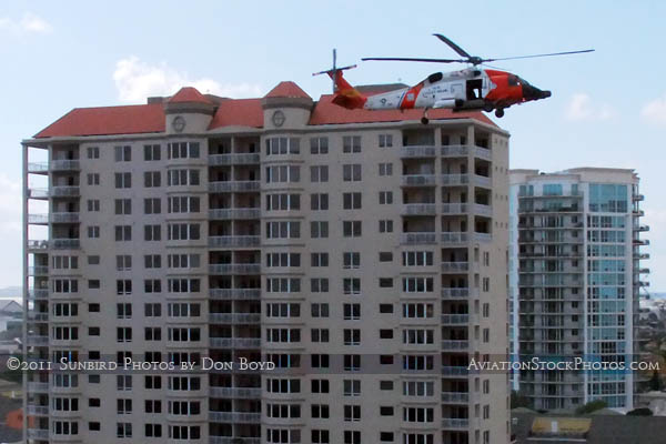 2011 - Coast Guard MH-60J #CG-6036 on a port and harbor patrol just south of downtown Tampa aviation stock photo
