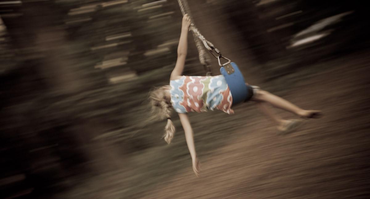 Girl On A Swing With One Shoe <br> (AV-082711-150-1.jpg)