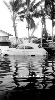 1947 - partially submerged vehicles in the Allapattah area after the Flood of 1947