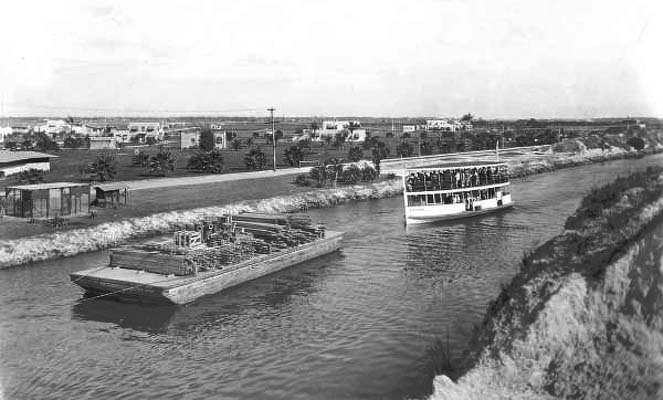 Late 1930s - the passenger launch Biscayne following a barge in the Miami Canal next to Hialeah