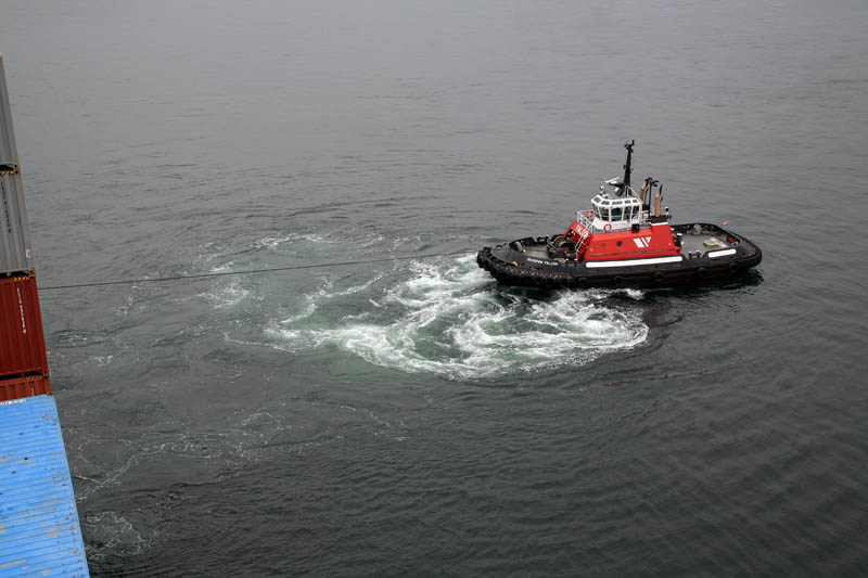 Tug Pulling Ship Away from Dock
