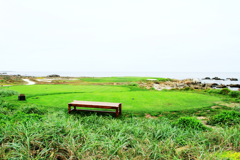 Golf and bench by the Pacific ocean, 17 Mile Drive, Monterey, California