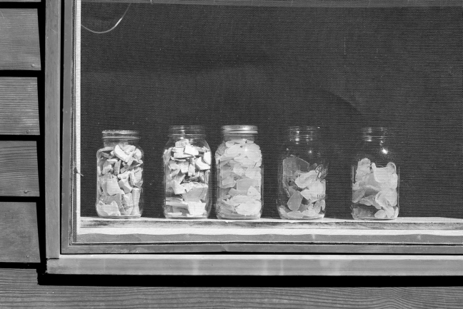 Jars of Sea Glass and Pottery Shards on Window Sill