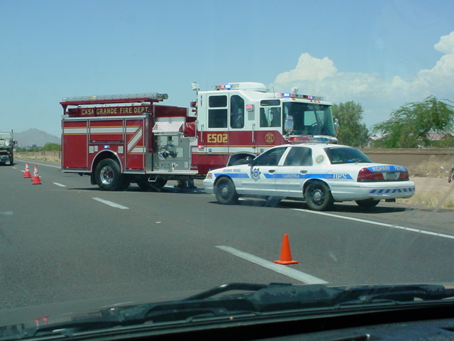 red fire truck and <br>Arizona highway patrol