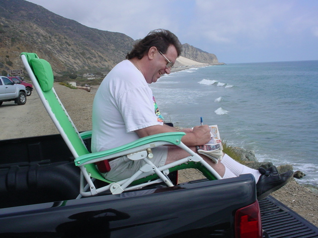 Jeff writing postcards<br>from Malibu California