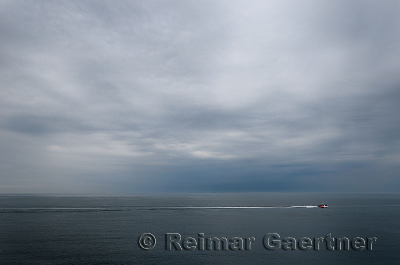 Canadian coastguard heading out of Yarmouth sound with stormy clouds