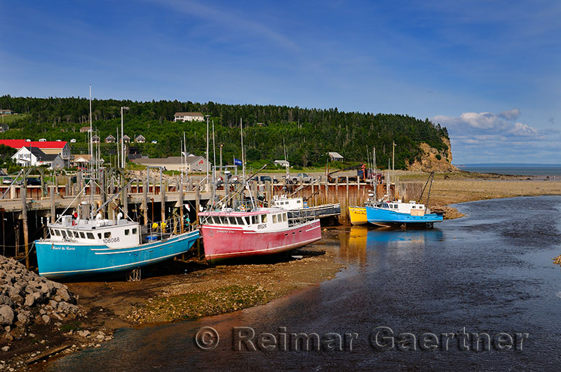 Upper Salmon River and fishing boats at low tide on the Bay of Fundy at Alma New Brunswick