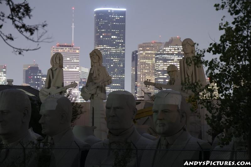 Giant Beatles statues in Houston at night