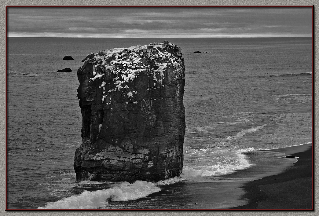 Black basalt rocks and sea shores.