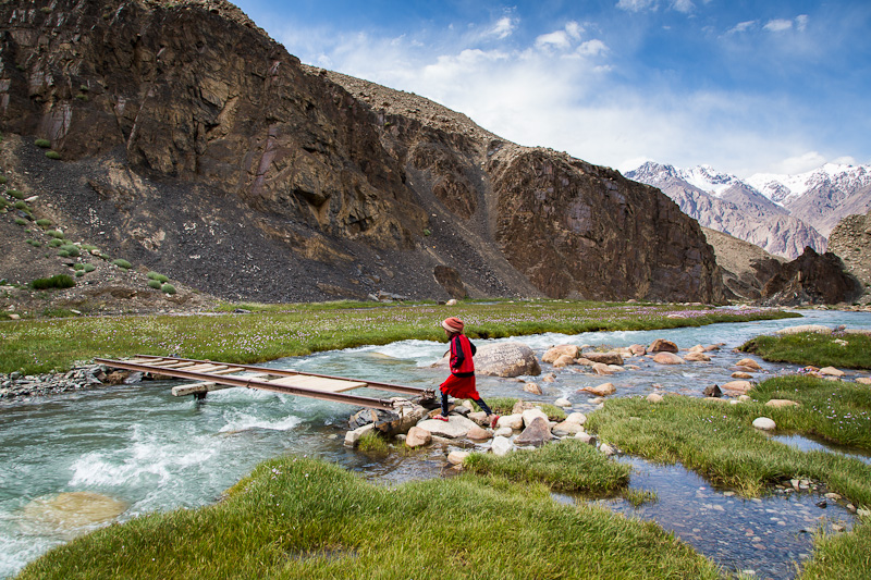 Girl leaping onto bridge - Tajikistan