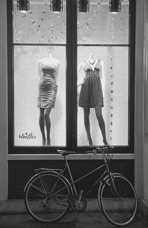 Two mannequins and a bicycle