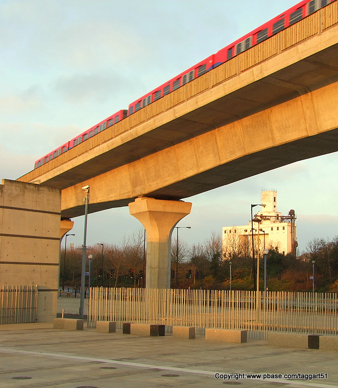 DLR train departing Pontoon Dock station