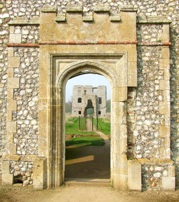 Baconsthorpe Castle; the first gatehouse through the doorway of the second.