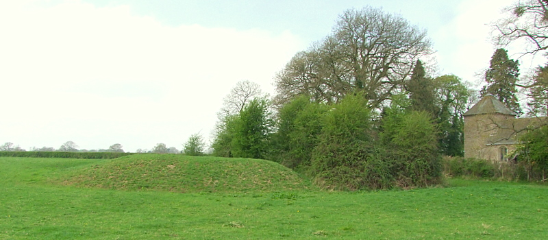 Leysters motte,with adjacent St.Andrews church building.