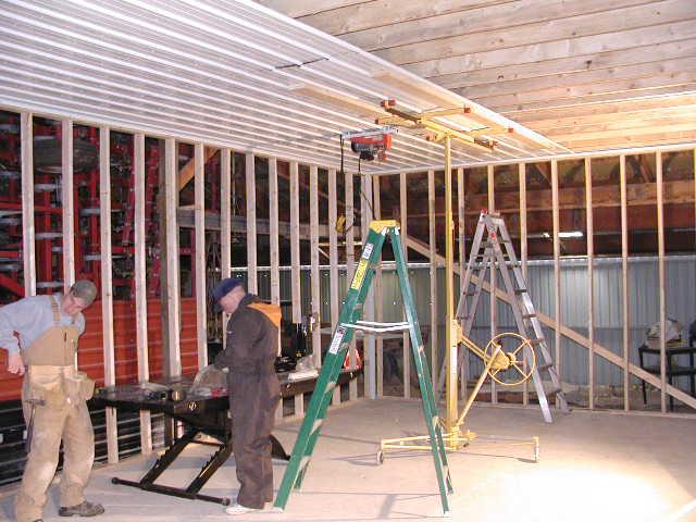 Tiny & Mark helping put steel on ceiling.JPG