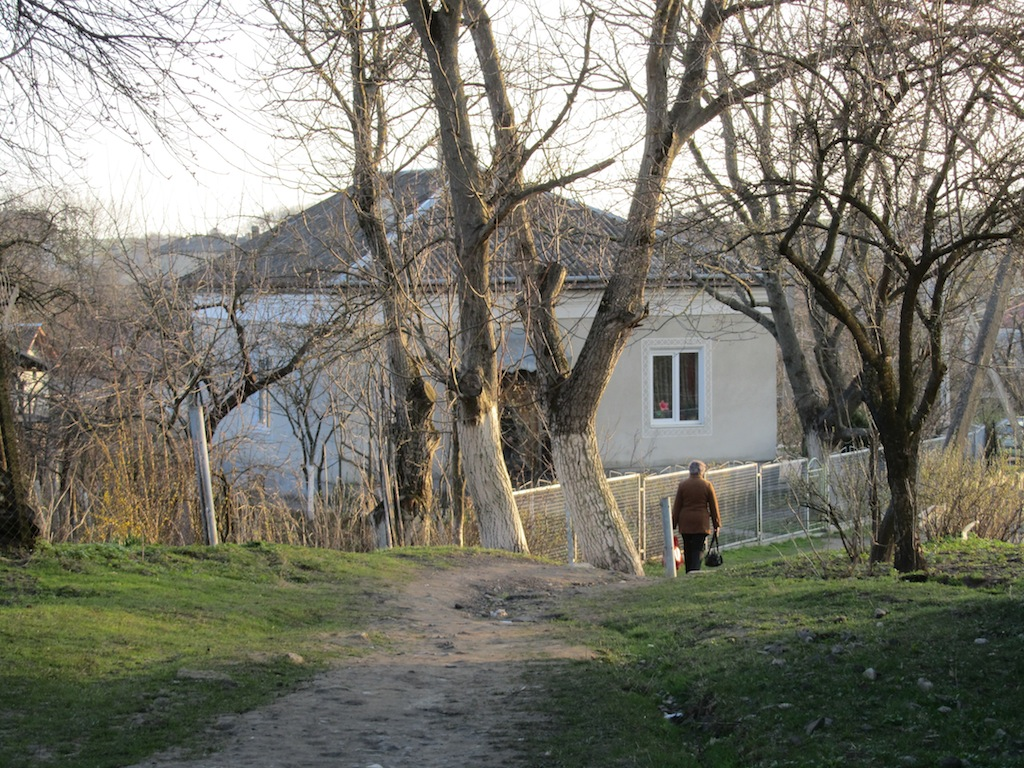 walking the old path between the houses