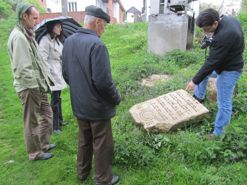 reviewing a set of Jewish gravestones outside the cemeteries, found by Mr. Vorobets and Ihor