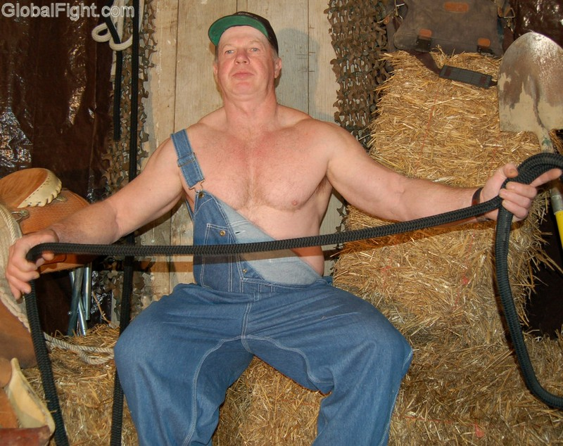 man wearing coveralls working tieing ropes overalls.jpeg