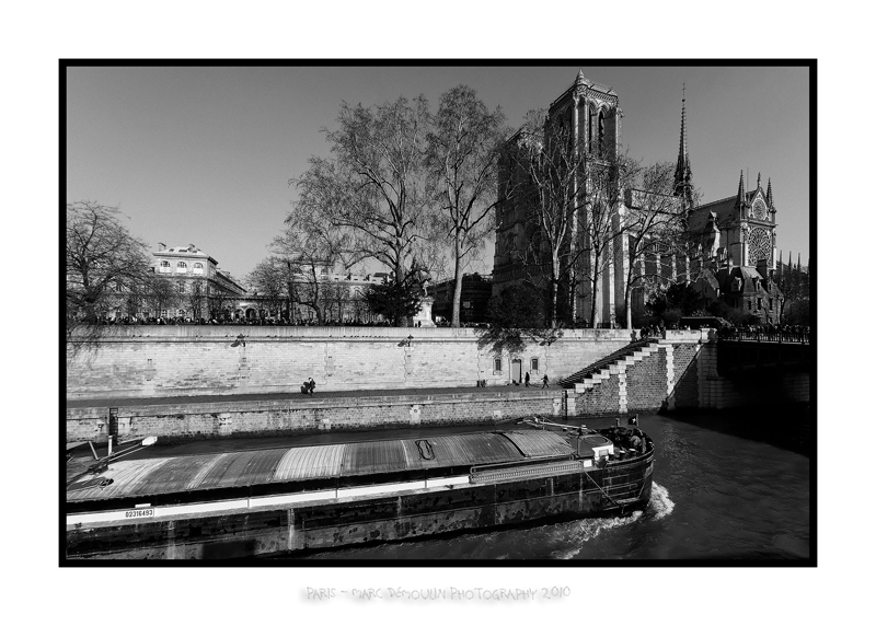 Barge passing along Notre Dame