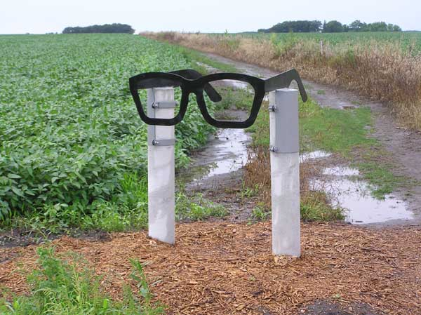 Glasses mark the trail to the Buddy Holly crash site