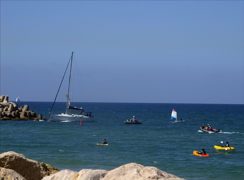 Boats and yachts entering Herzliya Marina on a winters day.jpg