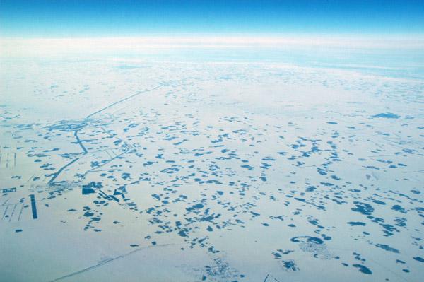 Siberia steppe in winter along the Russia-Kazakhstan border near Omsk, Russia