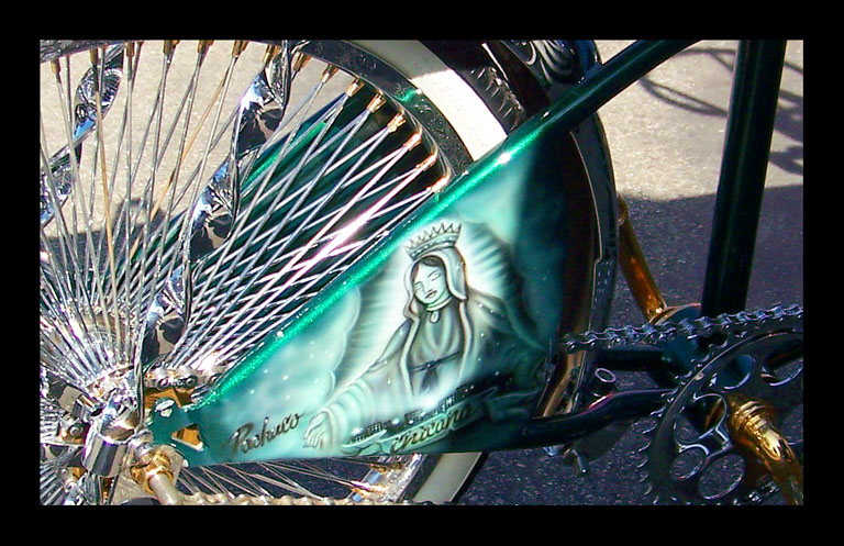 Chicana painted on a lowrider bike