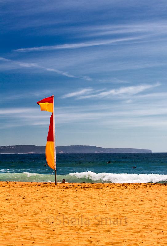Surf life saving flag at Palm Beach