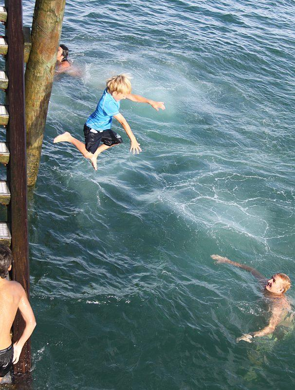 Zach, aged 6 jumping off the wharf