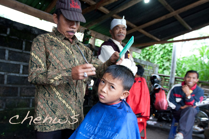 Young boy getting his haircut, watched by his grand father _CWS6124.jpg